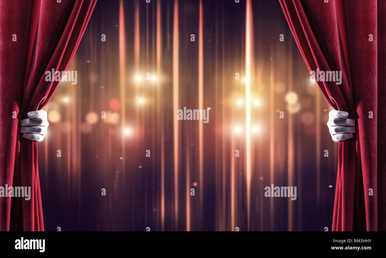 Bokeh lights behind drapery curtain and hand opening it - Stock Image