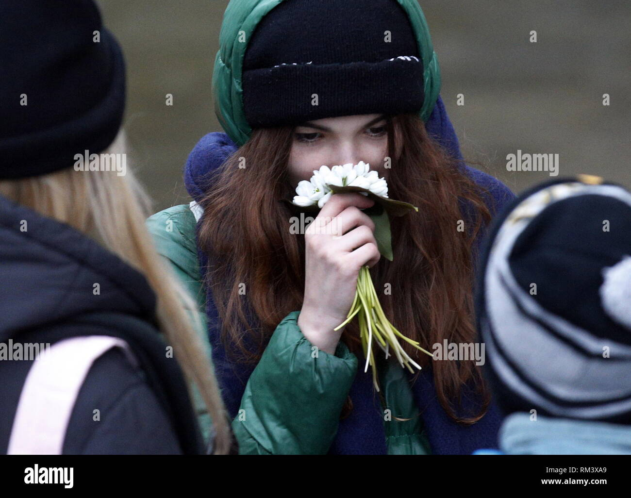 ROSTOV-ON-DON, RUSSIA - FEBRUARY 10, 2019: A girl smelling flowers. Valery Matytsin/TASS - Stock Image