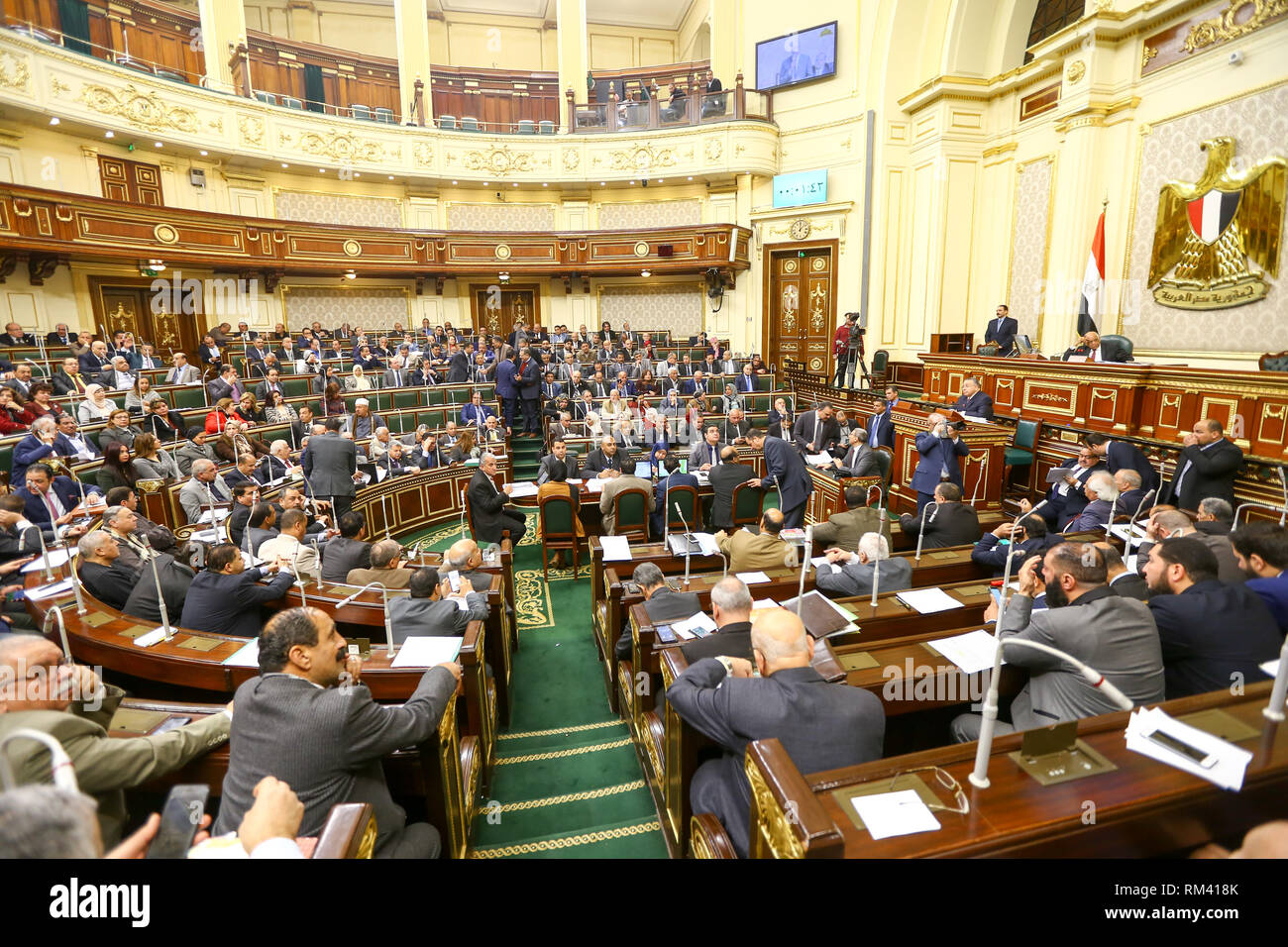 Cairo, Egypt. 13th Feb, 2019. A general view of a plenary seSsion at the Egyptian Parliament held to deliberate the proposed constitutional amendments that will increase the country's President term in office from four to six years. The Parliament members will vote later on the amendments before referring it to the Legislative and Constitutional Affairs Committee to be discussed in detail and to be finalized before being referred to the president to be put up for a public vote in a national referendum. Credit: Lobna Tarek/dpa/Alamy Live News - Stock Image
