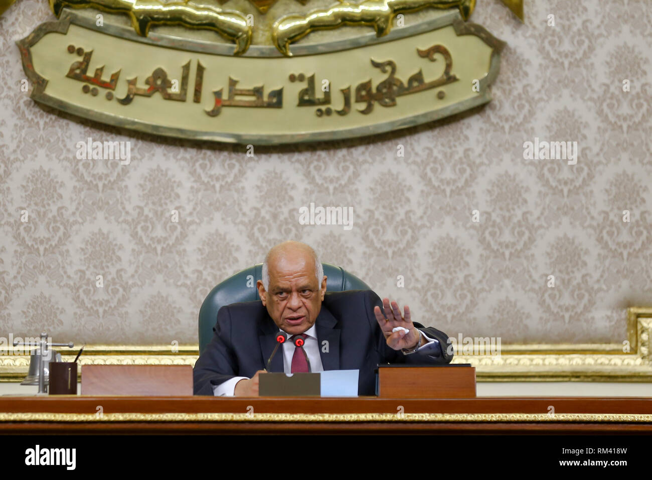 Cairo, Egypt. 13th Feb, 2019. Egypt's Parliament Speaker Ali Abdel Aal presides a plenary session to deliberate the proposed constitutional amendments that will increase the country's President term in office from four to six years. The Parliament members will vote later on the amendments before referring it to the Legislative and Constitutional Affairs Committee to be discussed in detail and to be finalized before being referred to the president to be put up for a public vote in a national referendum. Credit: Lobna Tarek/dpa/Alamy Live News - Stock Image
