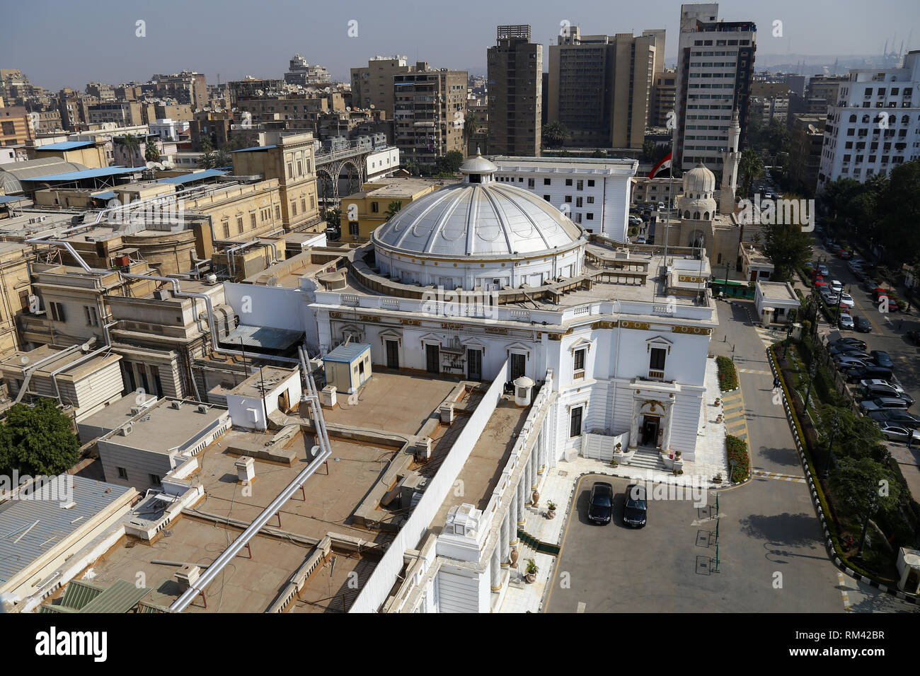 Cairo, Egypt. 13th Feb, 2019. A view of the building of the Egyptian Parliament. The parliament held a plenary session today to deliberate the proposed constitutional amendments that will increase the country's President term in office from four to six years. The Parliament members will vote later on the amendments before referring it to the Legislative and Constitutional Affairs Committee to be discussed in detail and to be finalized before being referred to the president to be put up for a public vote in a national referendum. Credit: Lobna Tarek/dpa/Alamy Live News - Stock Image