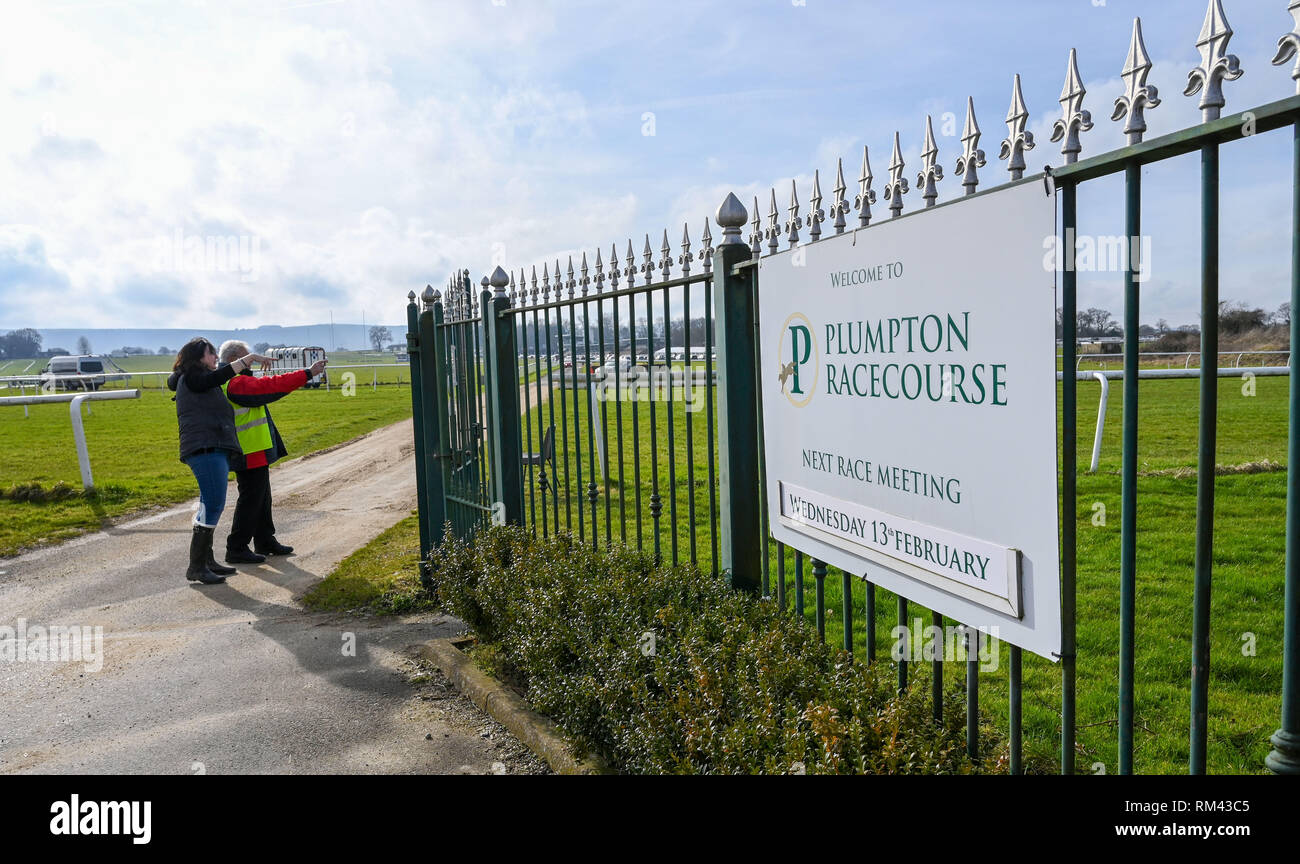 Brighton, UK. 13th Feb, 2019. Punters arrive as racing is back under way again at Plumpton Racecourse in Sussex after the recent suspension of horse racing throughout Britain due to an outbreak of equine flu Credit: Simon Dack/Alamy Live News - Stock Image
