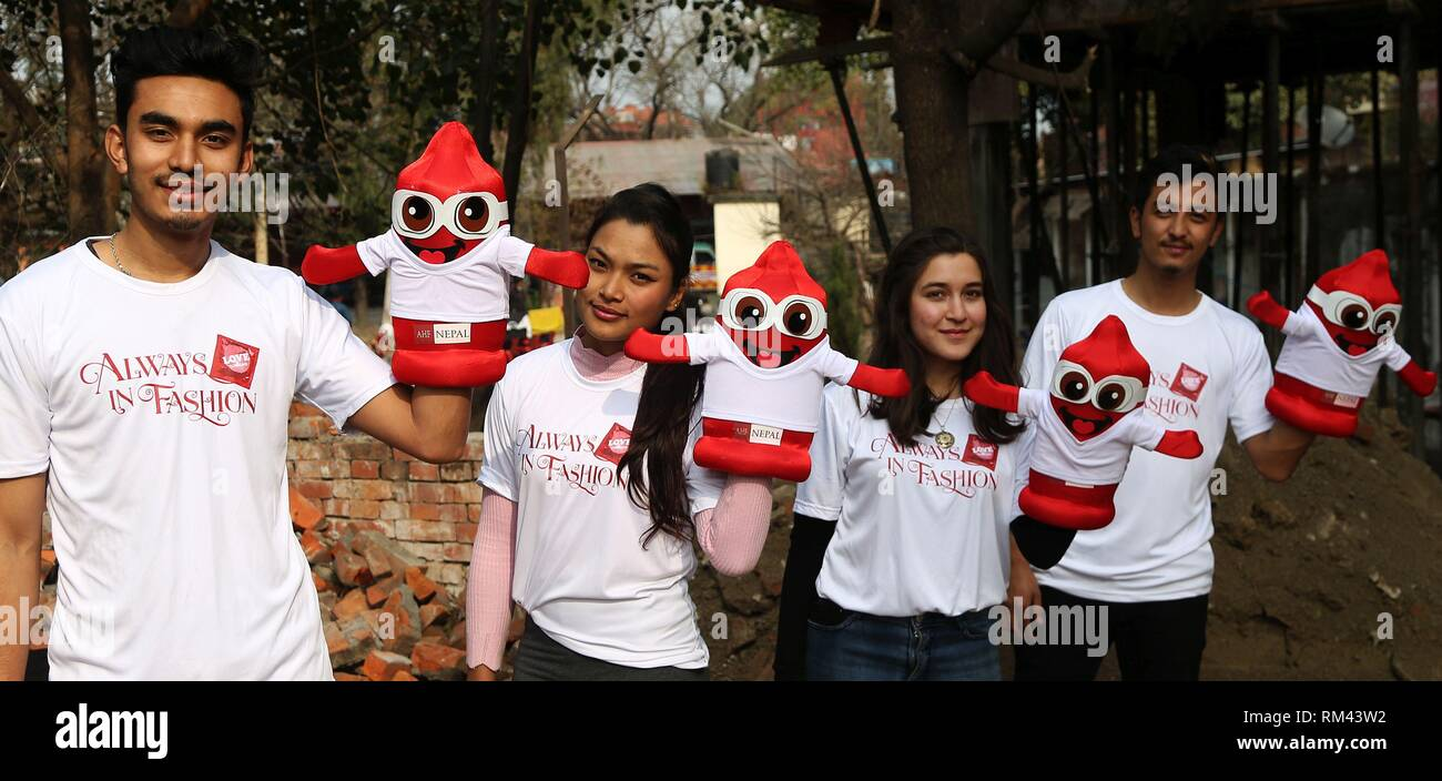 (190213) -- BHAKTAPUR, Feb. 13, 2019 (Xinhua) --     Nepalese youth participate in the celebration of International Condom Day at Bhaktapur, Nepal, Feb. 13, 2019.     The day was set to recognize the importance of condoms as a dual method for prevention of unplanned pregnancies as well as sexually transmitted infections.     (Xinhua/Sunil Sharma) - Stock Image