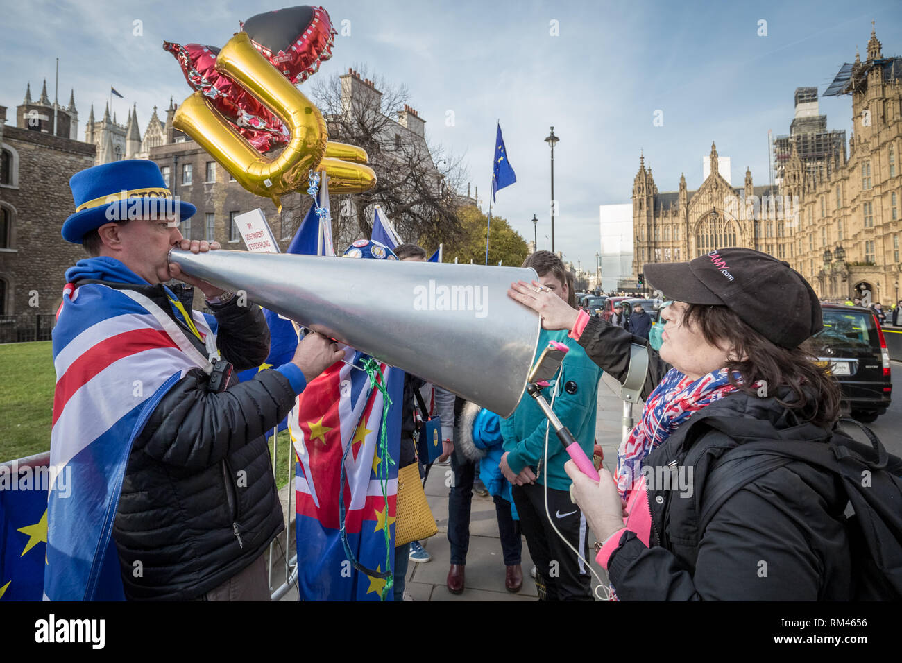 London, UK. 13th Feb 2019. Stop Brexit: Pro-EU supporter, Steve Bray, (L) is challenged by a right-wing Brexiteer (R) during on-going protests in Westminster. Credit: Guy Corbishley/Alamy Live News - Stock Image