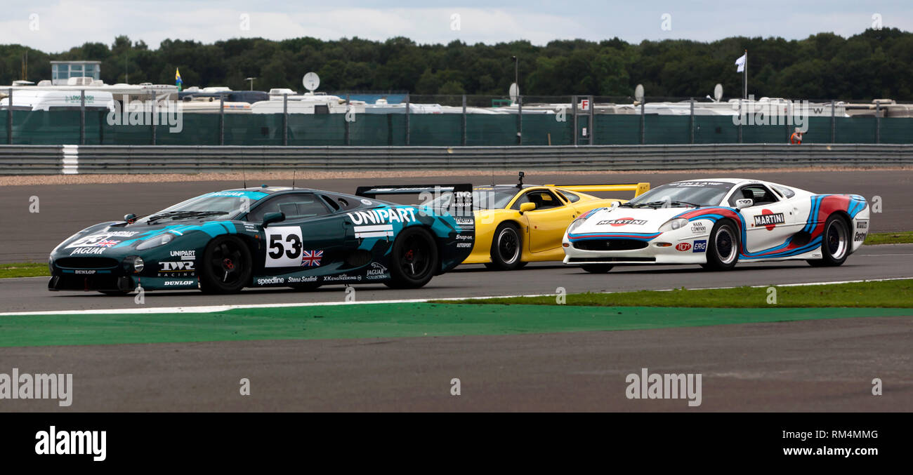 A special celebration and a record-breaking track parade, at the 2017 Silverstone Classic,  to mark the 25th anniversary of the Jaguar XJ220, - Stock Image