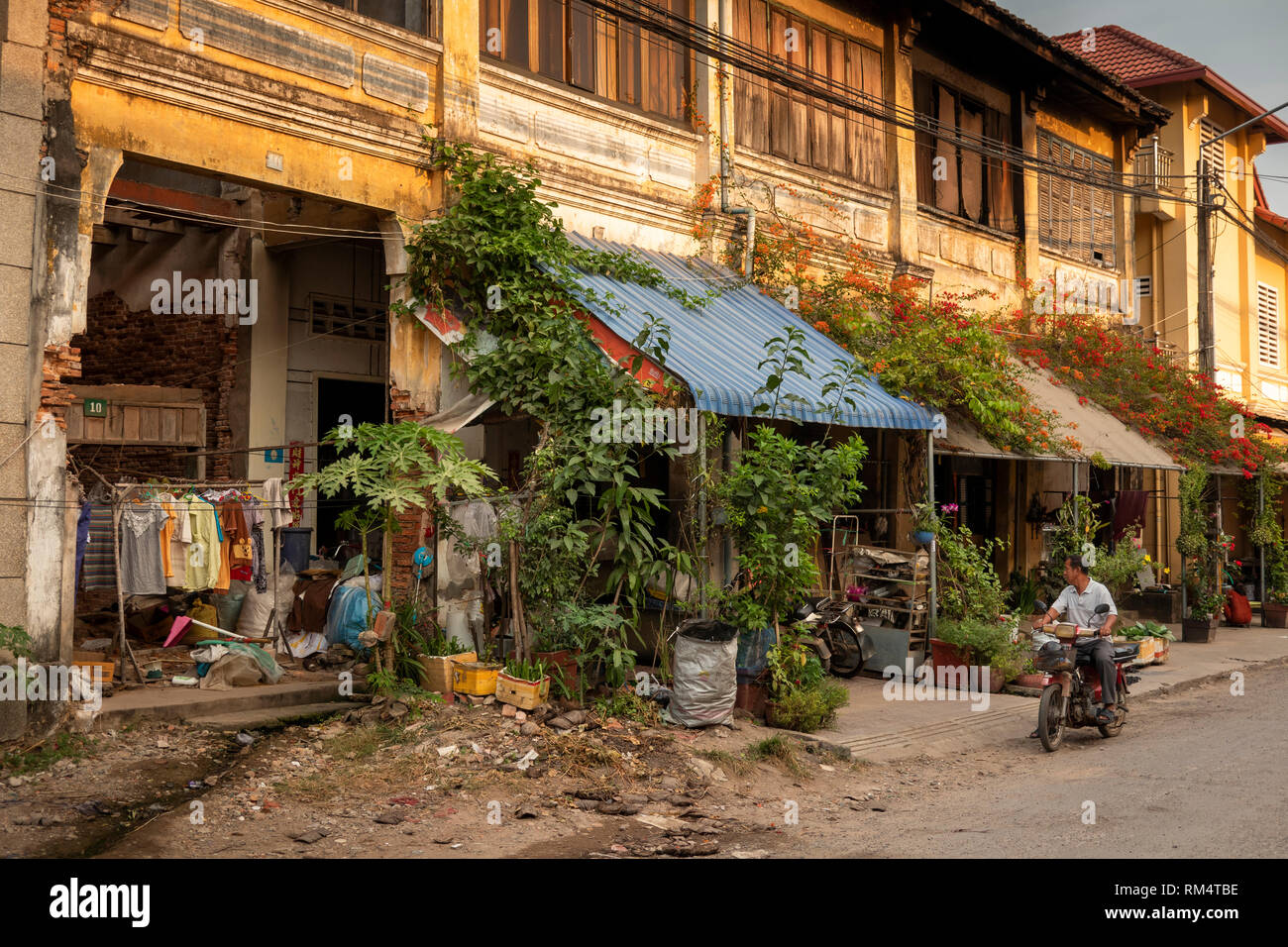 Cambodia, Kampot Province, Kampot city, Street 703, unrestored decaying old French colonial buildings inOld Market area - Stock Image