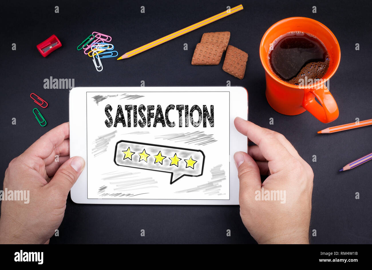 Satisfaction concept. Text and icon on tablet device - Stock Image