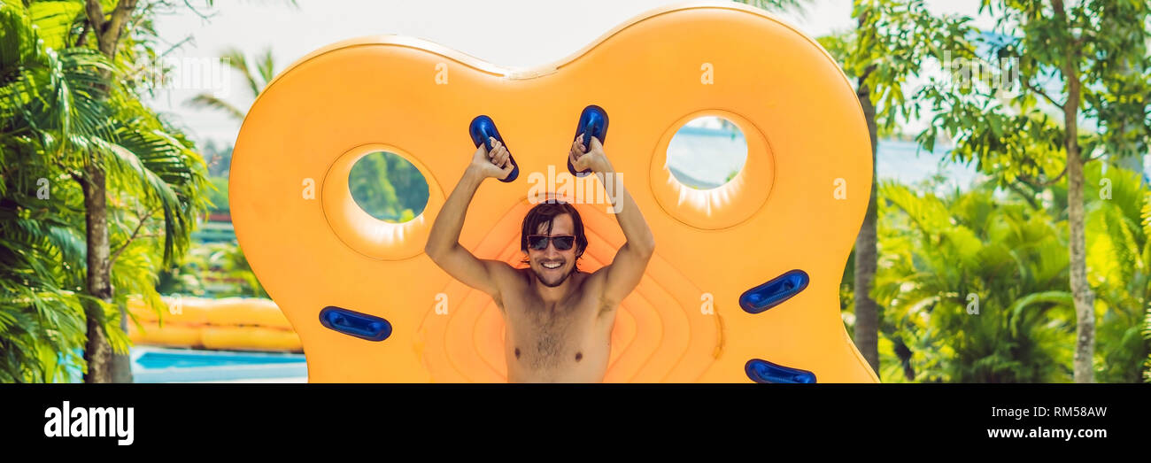 Man having fun at water park. BANNER, long format - Stock Image