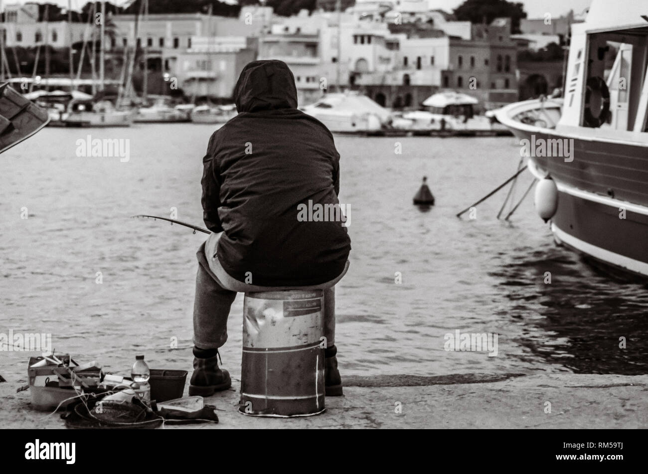 old unemployed man fishing - Stock Image