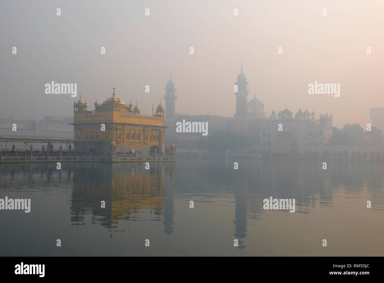 Golden temple shrouded by high levels of air pollution in Amritsar, Punjab, India - Stock Image