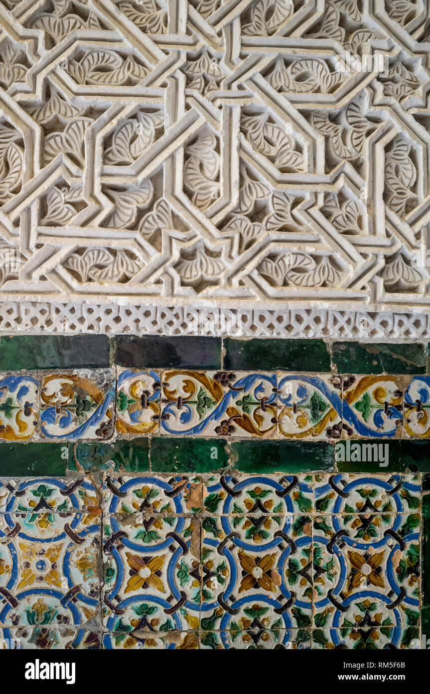 Mudejar wall tiles and marble fretwork in the Real Alcazar, Seville, Andalucia, Spain - Stock Image