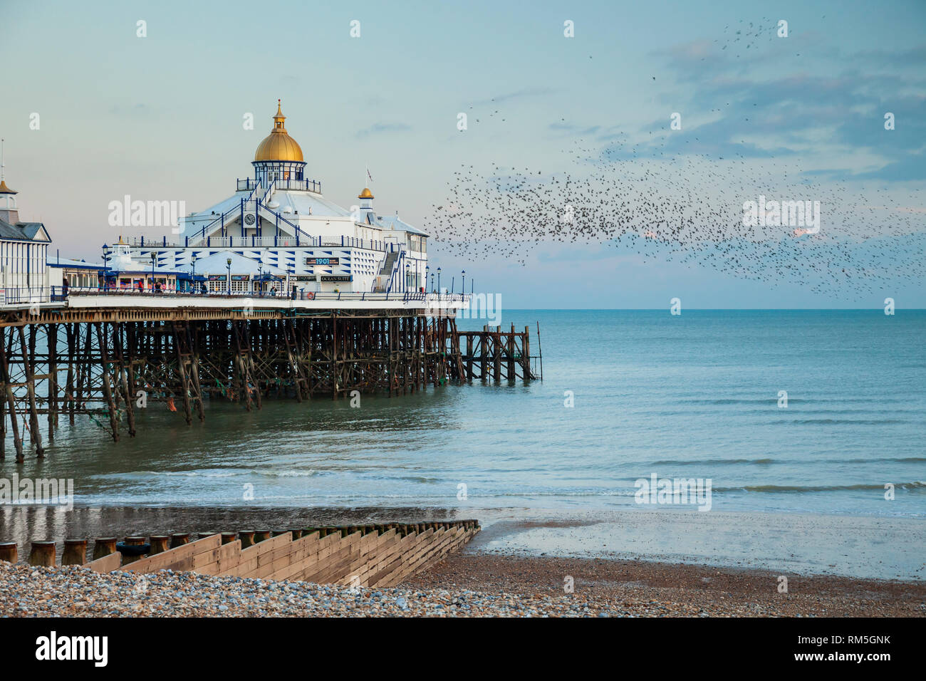 Evening at Eastbourne Pier in East Sussex, England. Stock Photo