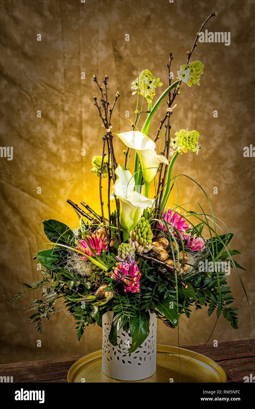 flower bouquet in vase an wall Stock Photo