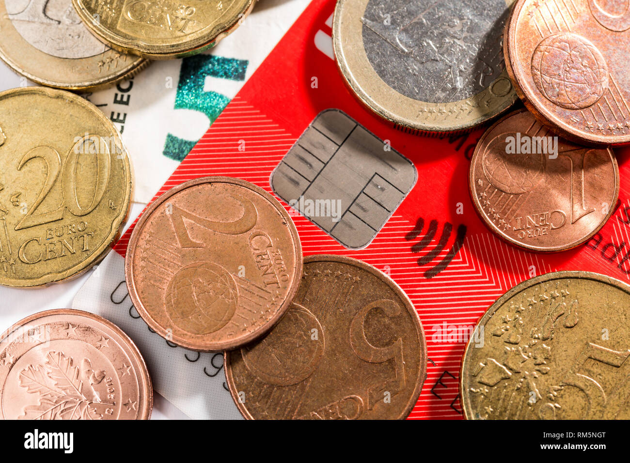 EC Card with Euro coins Stock Photo
