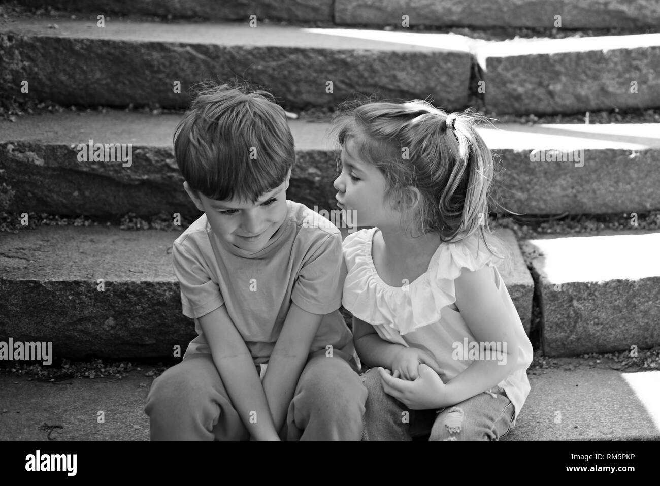 Girl kissing boy black and white stock photos images alamy