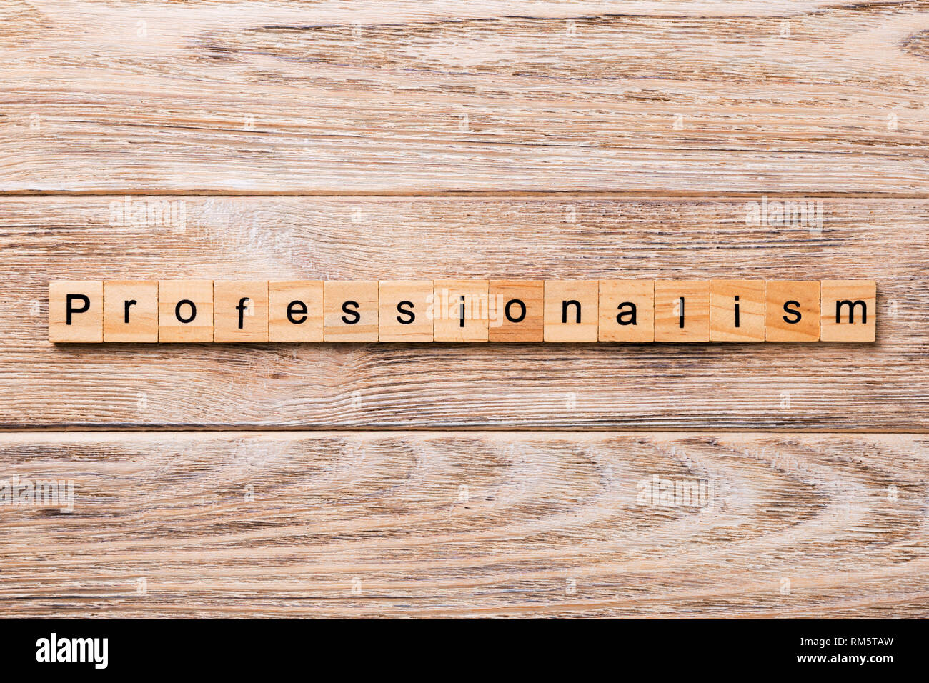Professionalism word written on wood block. Professionalism text on wooden table for your desing, concept. - Stock Image