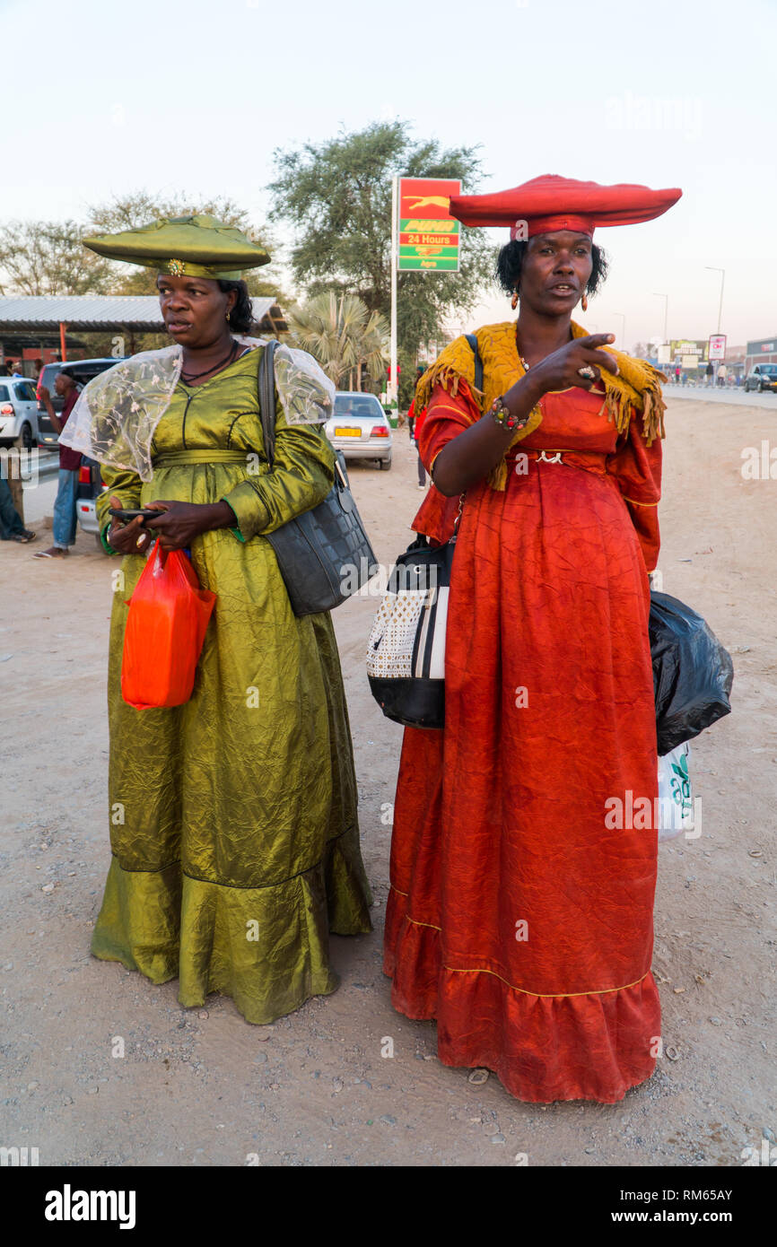 Herero women in traditional dress. The Herero, (AKA Ovaherero), are an ethnic group inhabiting parts of Southern Africa. The majority reside in Namibi - Stock Image