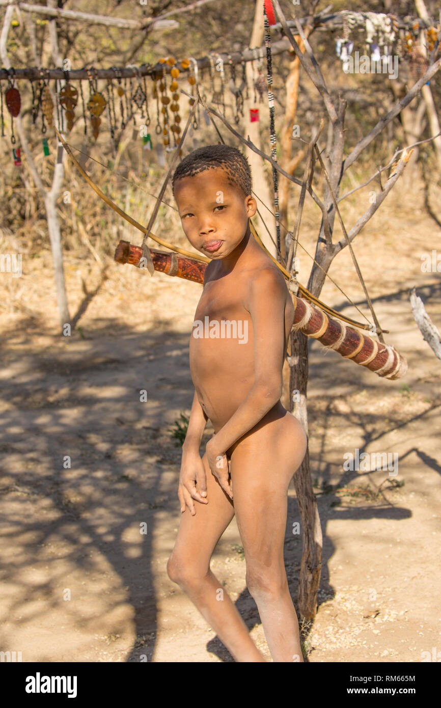 Portrait of a Bushman child. Photographed in Namibia - Stock Image
