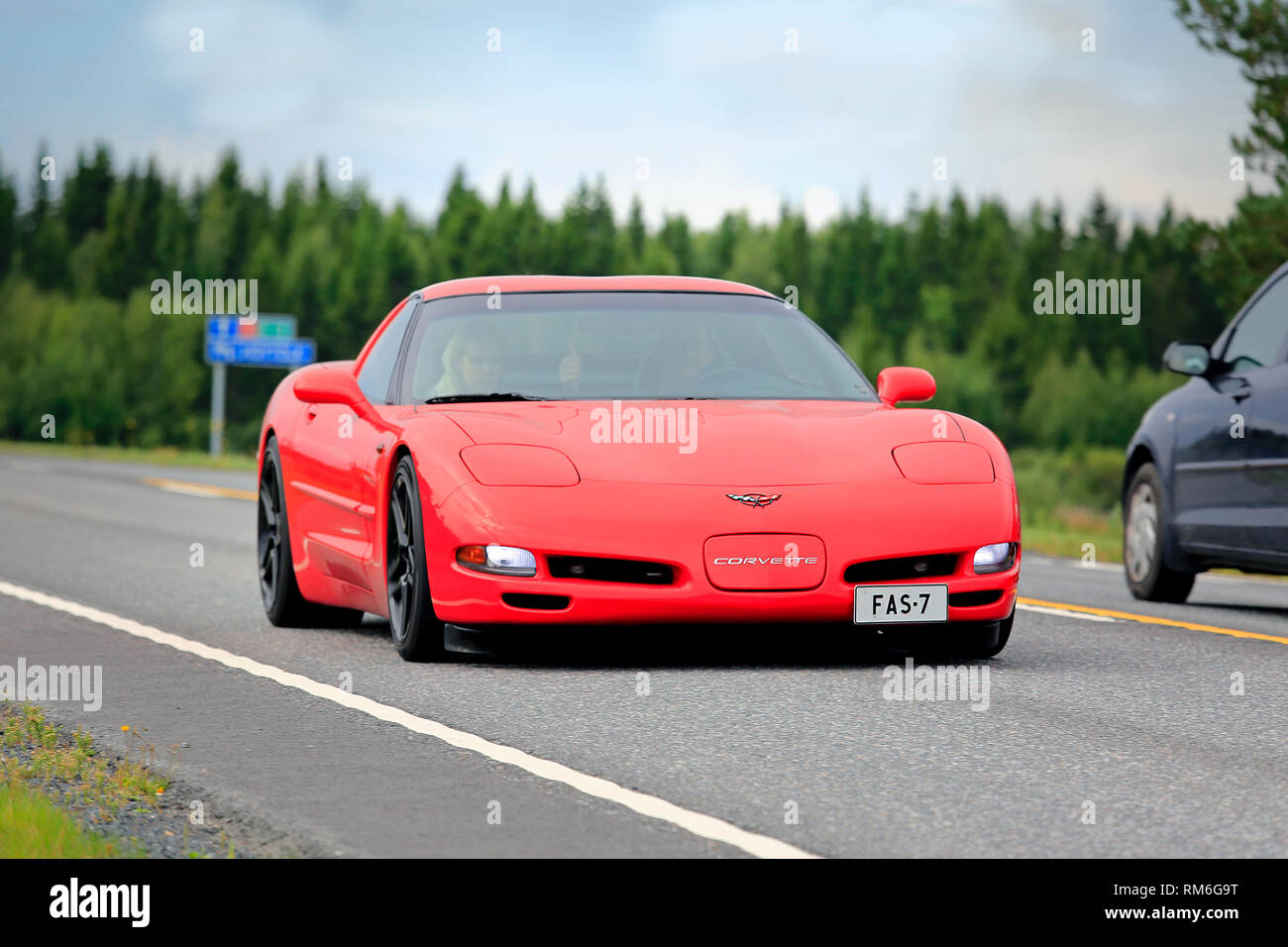 Ikaalinen, Finland - August 12, 2018: Red Chevrolet Corvette sports car cruising along highway on a day of summer. Stock Photo