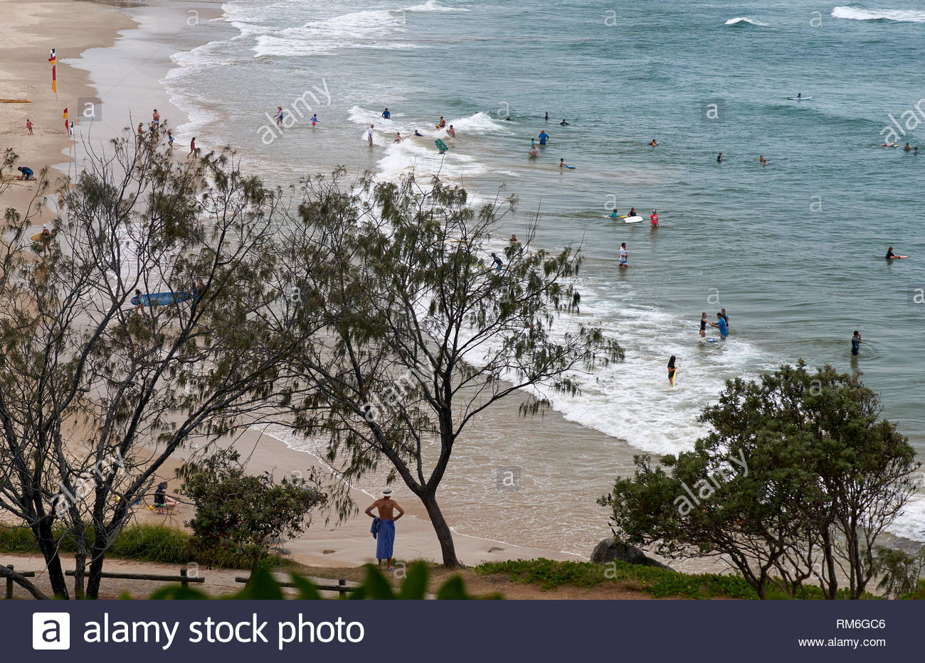 Lots of people cooling off in the water - swimming at Turners Beach - during a hot day of the Australian summer in 2019; at Yamba, NSW, Australia. - Stock Image