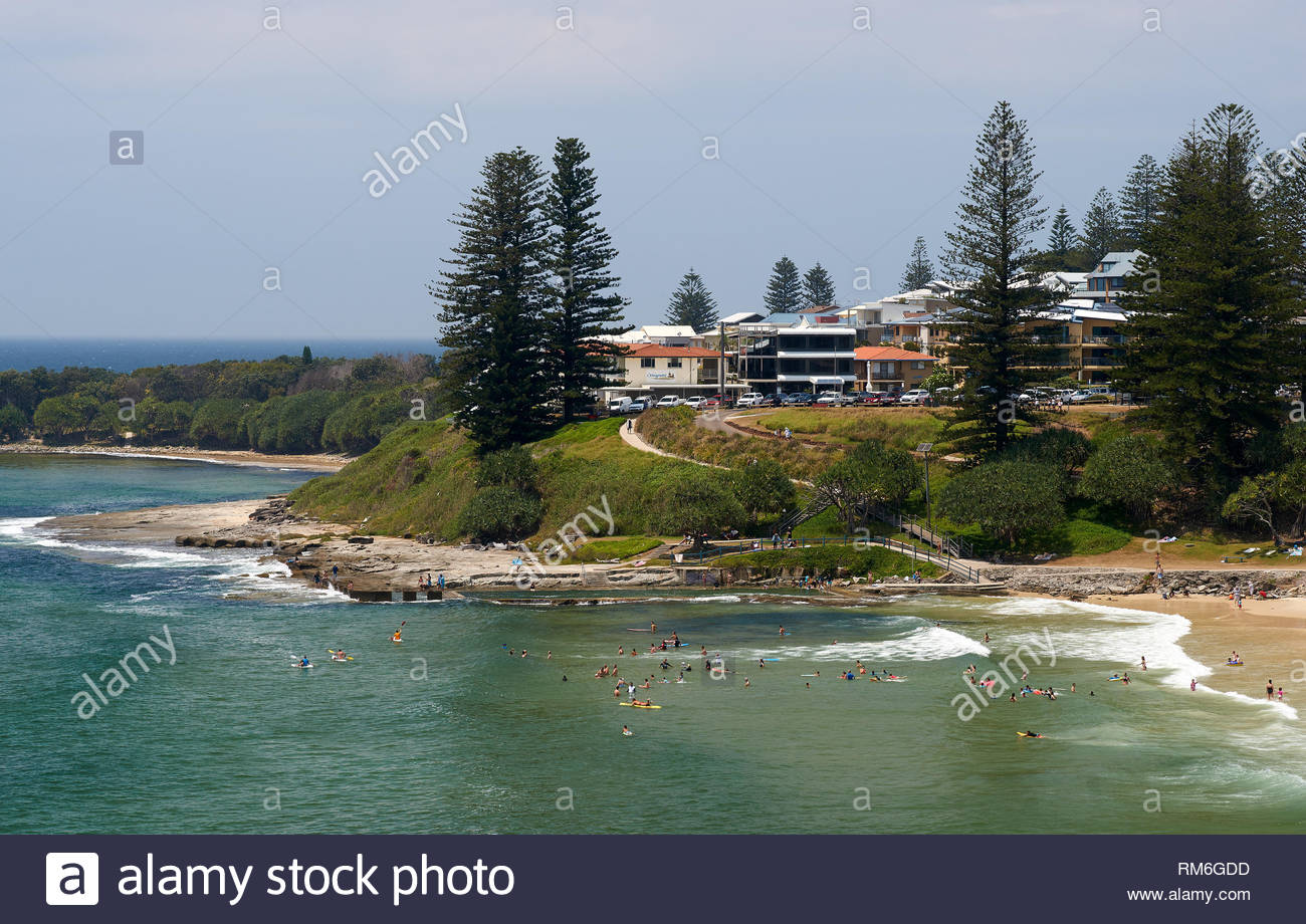 Lots of people cooling off - swimming at Yamba Main Beach - during a hot day of the Australian summer in 2019; at Wooli Bay, Yamba, NSW, Australia. - Stock Image