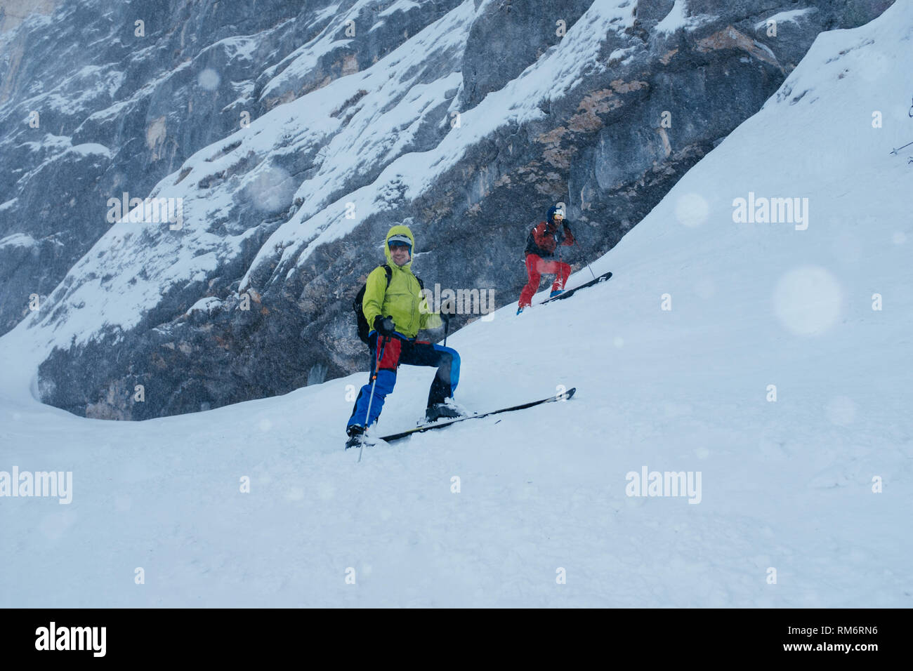 Group of friends skiing in whiteout - Stock Image
