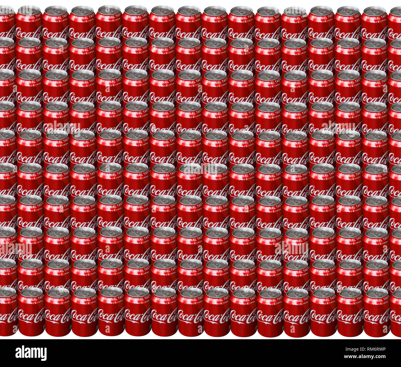 Lots of Coca Cola drink cans standing side by side in rows seen from above - The drink is produced and manufactured by The Coca-Cola Company - Image - - Stock Image