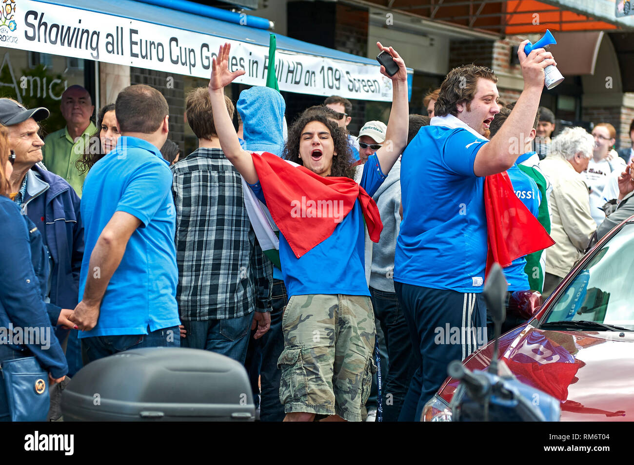 Vancouver, B.C., Canada - June 28, 2012: Italian football fans clebrating the victory at the semi finals at the 2012 UEFA European Championship Stock Photo