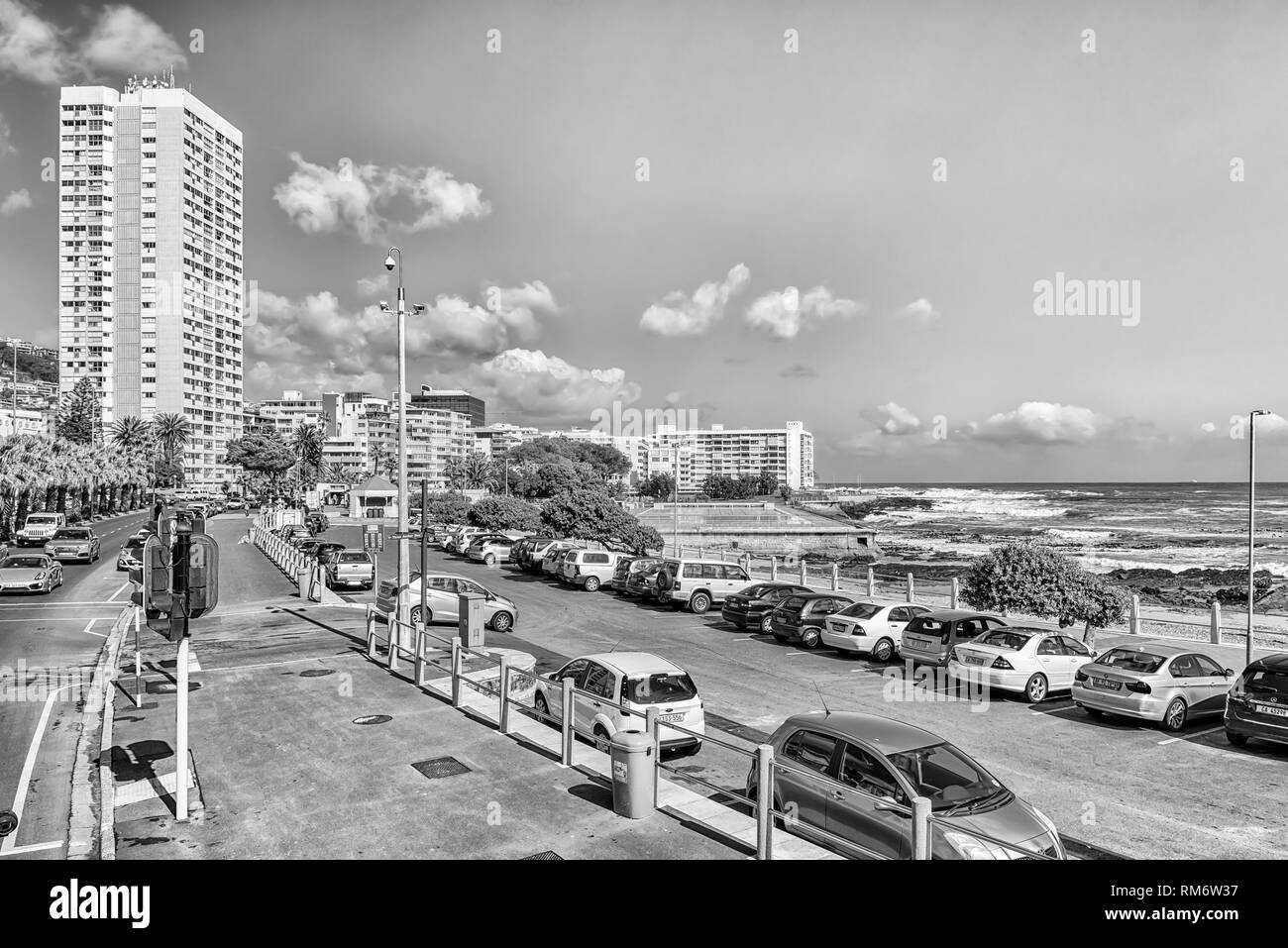 CAPE TOWN, SOUTH AFRICA, AUGUST 17, 2018: A view of Beach Road and Sea Point in Cape Town. The Atlantic Ocean, buildings and vehicles are visible.  Mo - Stock Image