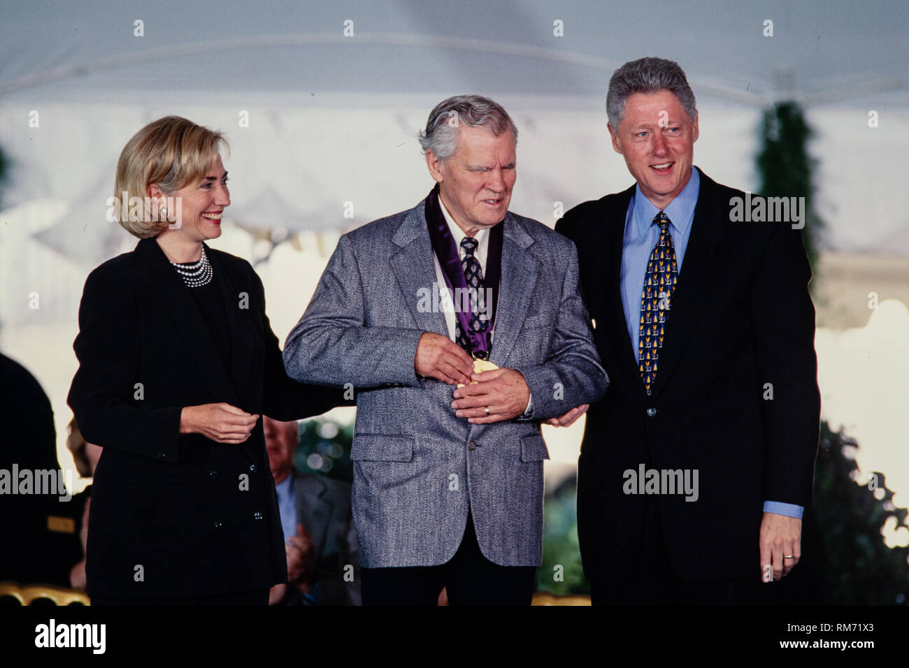 Mexican-American writer and literary critic Luis Leal is presented the National Medal of Arts by President Bill Clinton and First Lady Hillary Clinton during a ceremony on the South Lawn of the White House September 29, 1997 in Washington, DC. - Stock Image
