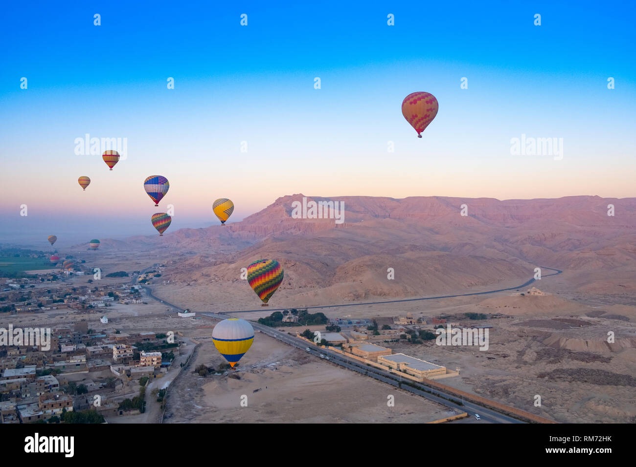 Hot air balloons at sunrise over the Valley of the Kings, Luxor, Egypt - Stock Image