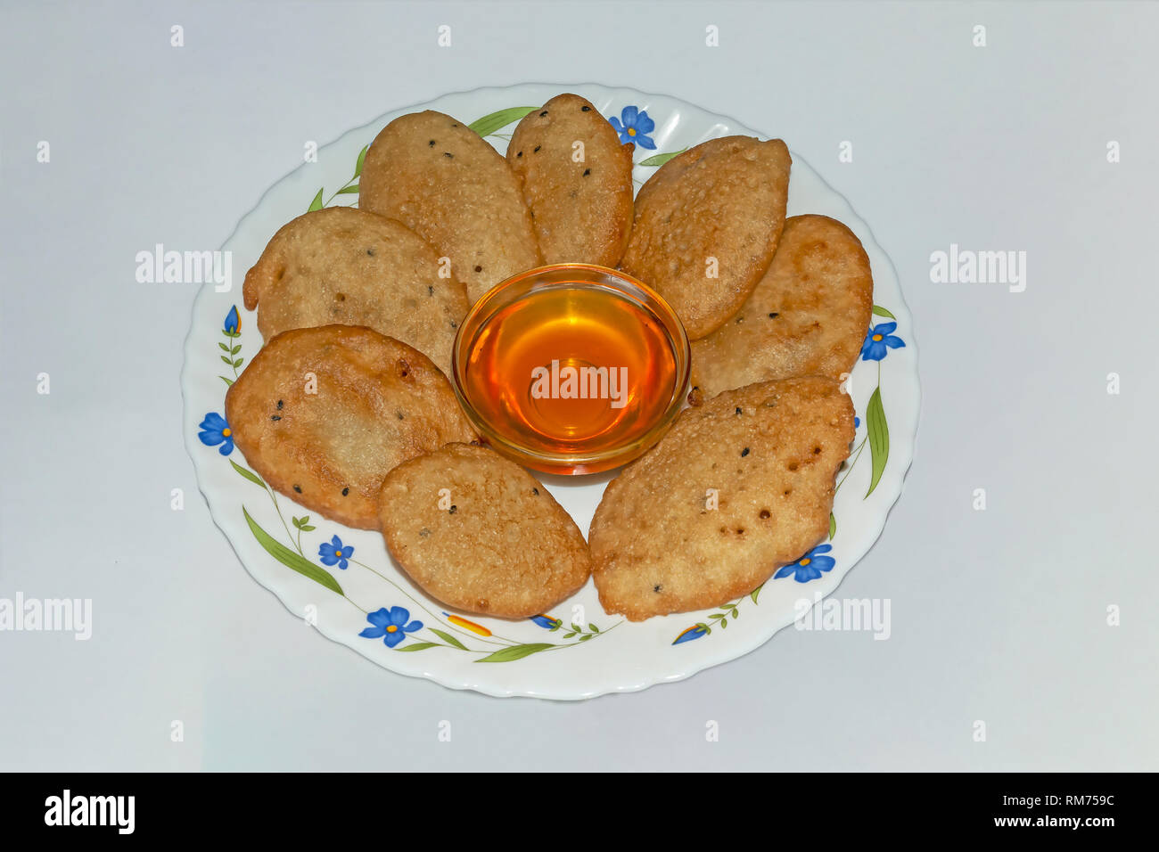 Malpua- Indian traditional dessert or pancake for festivals, served in plate with Jaggery Syrup. - Stock Image