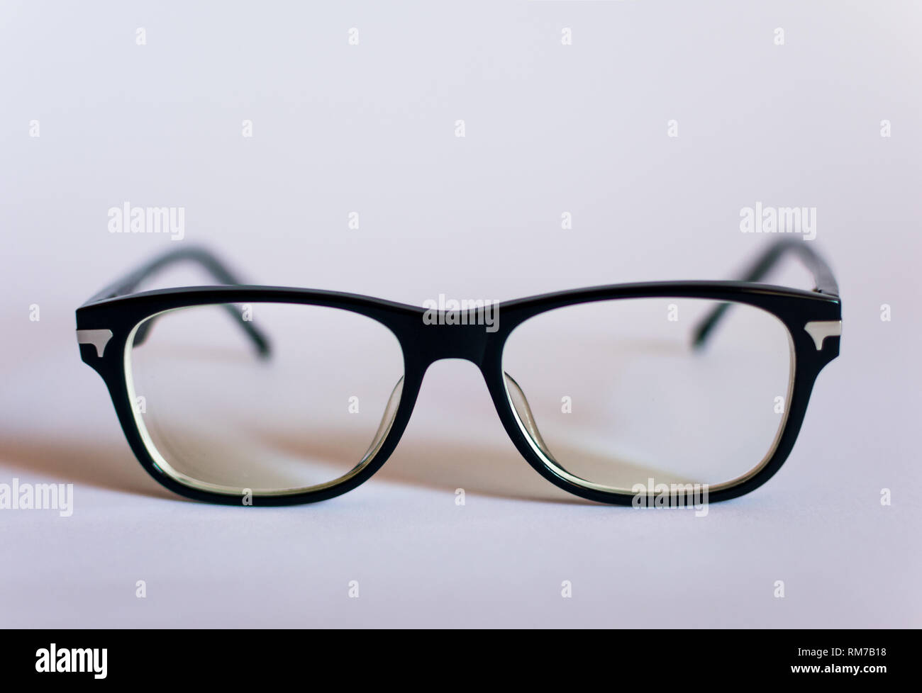 Anti blue light computer glasses on the white background. Glasses to protect your computer vision. - Stock Image