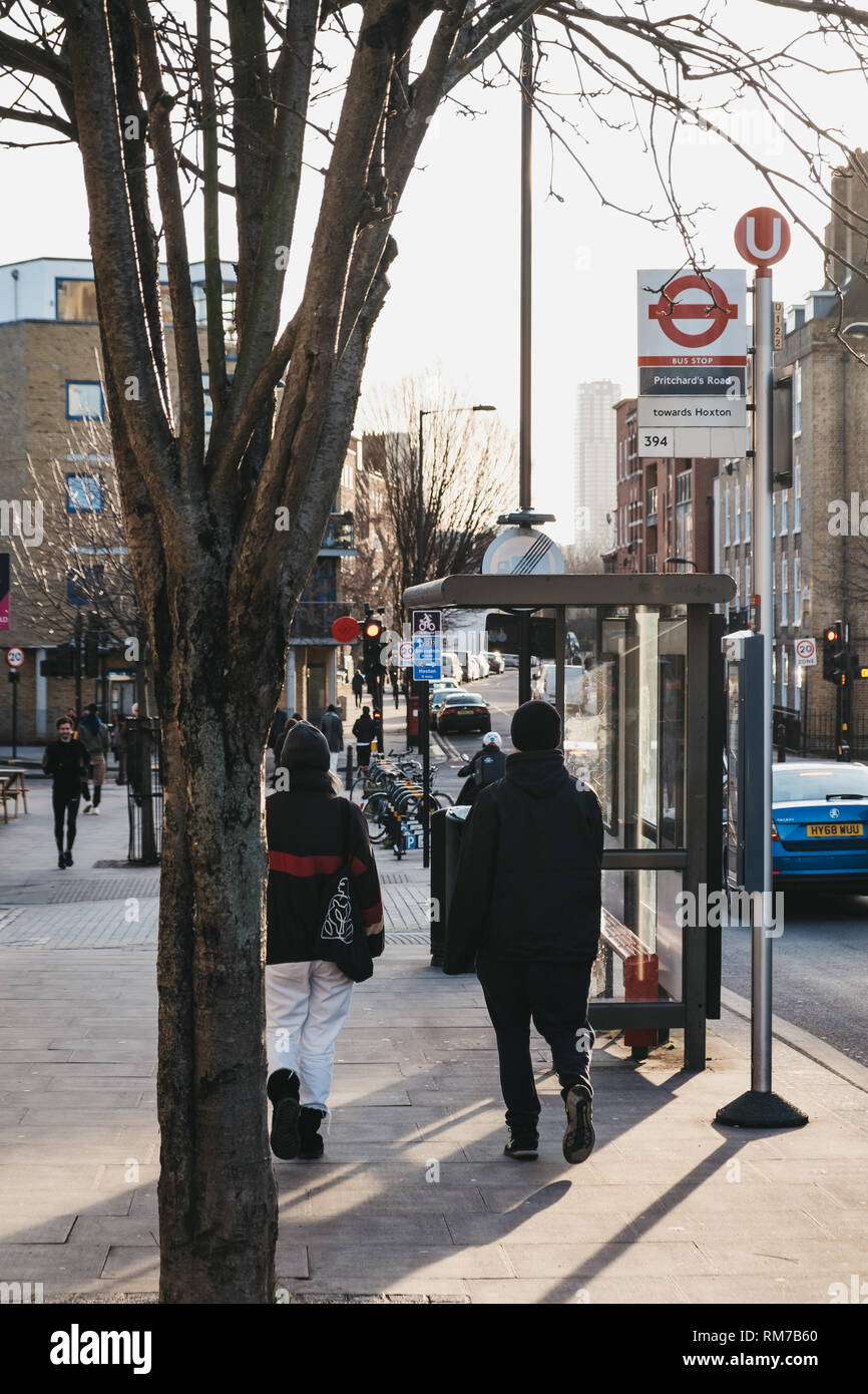 People walking on a street in Hackney, the largest of the seven boroughs that make up East London. - Stock Image
