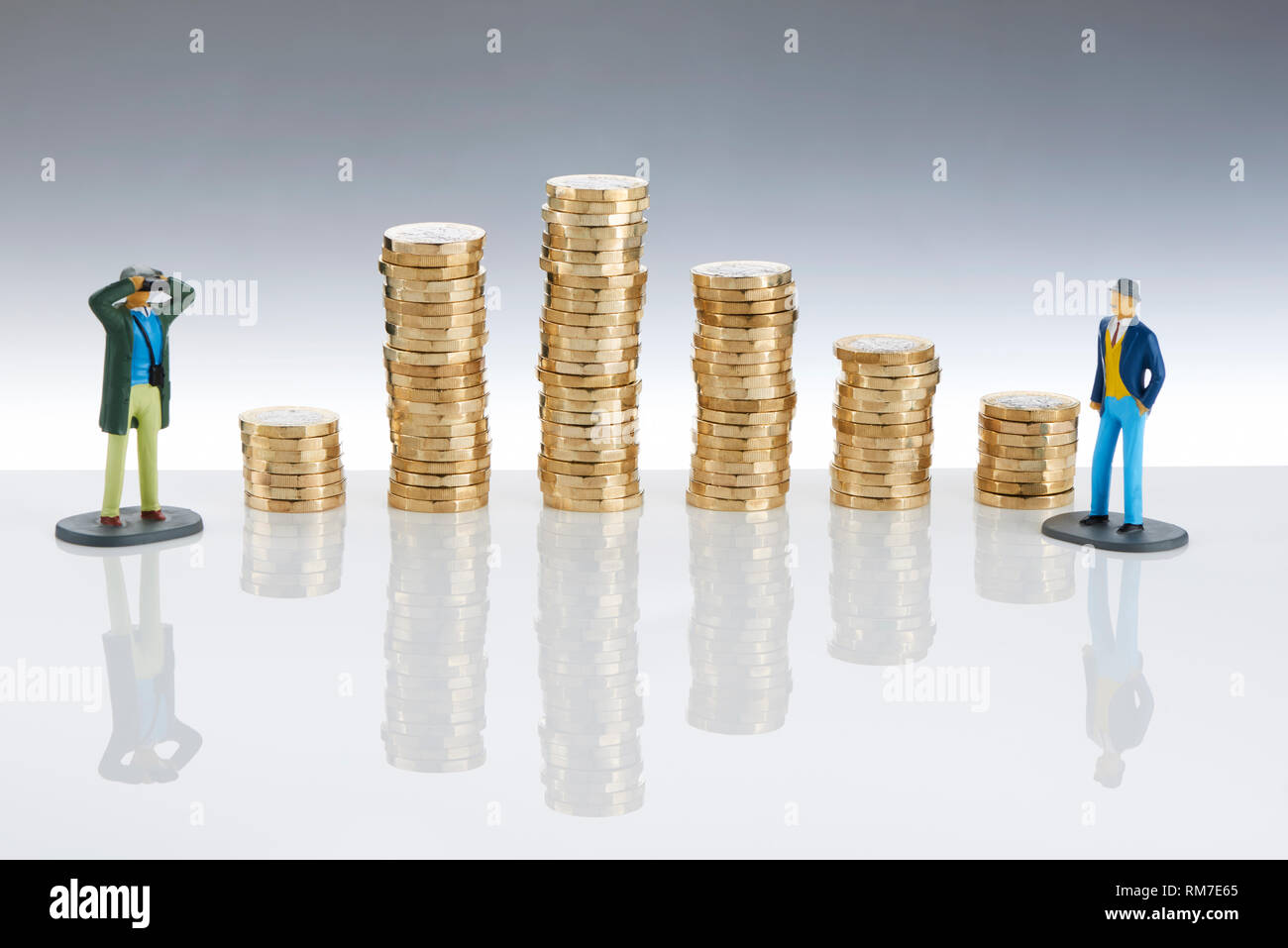 Stacks £1 Pounds with Model Men Looking on Stock Photo