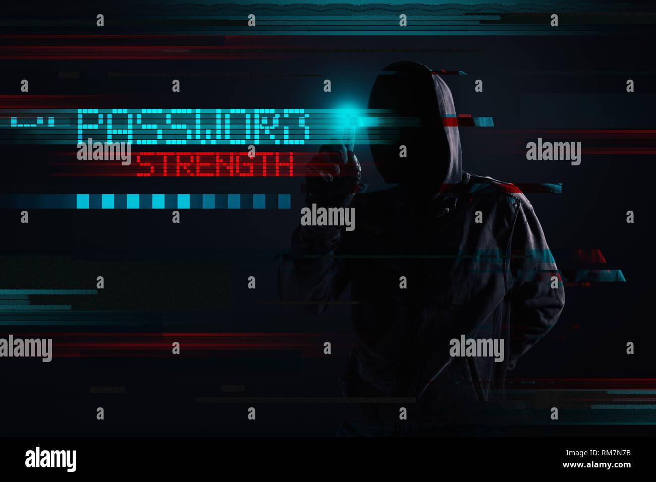 Hooded hacker in password strength concept, digitally enhanced image - Stock Image