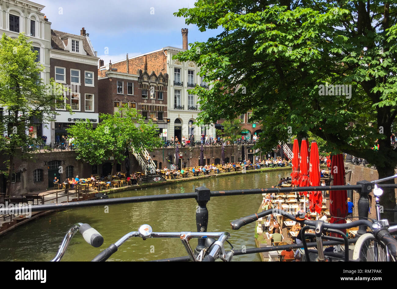 Amazing view on a lot of outdoor cafes alongside the Oudegracht (Old Canal) in the center of Utrecht, Netherlands Stock Photo