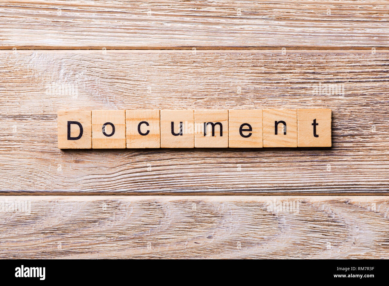 Document word written on wood block. Document text on wooden table for your desing, concept. - Stock Image