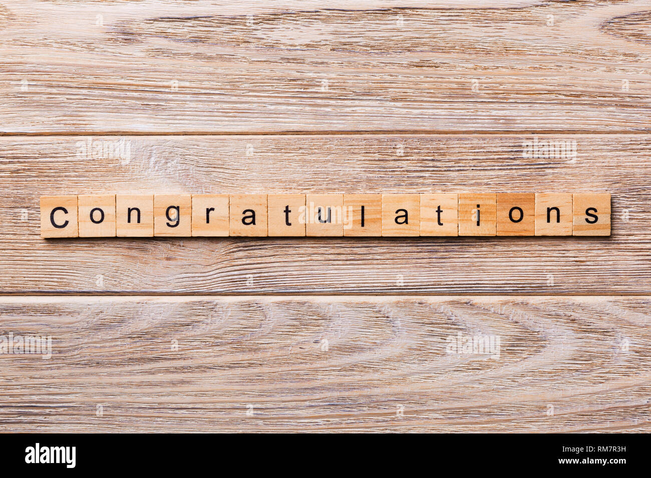 congratulations word written on wood block. congratulations text on wooden table for your desing, concept. - Stock Image