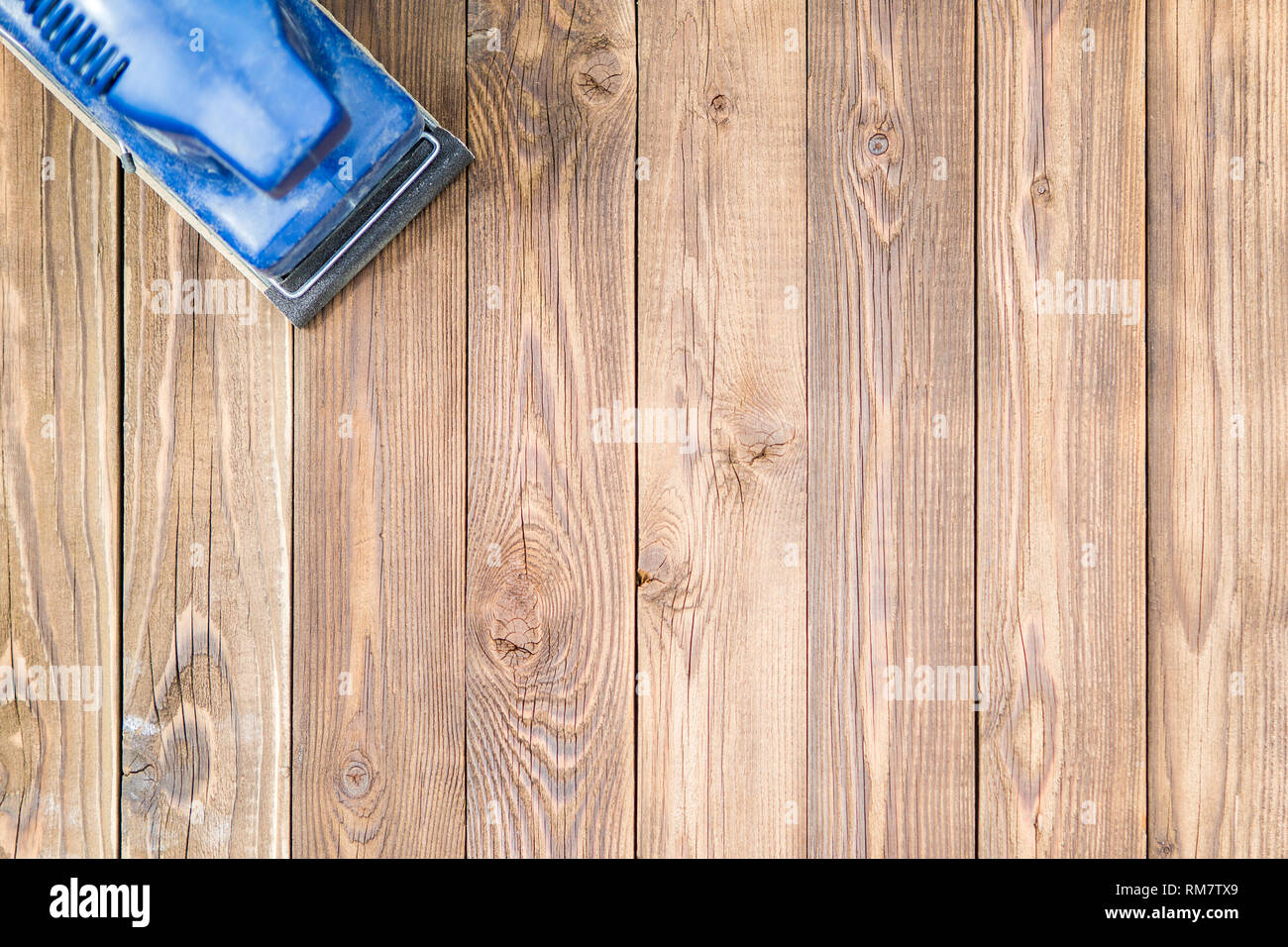 Wooden surface and blue grinder - Stock Image