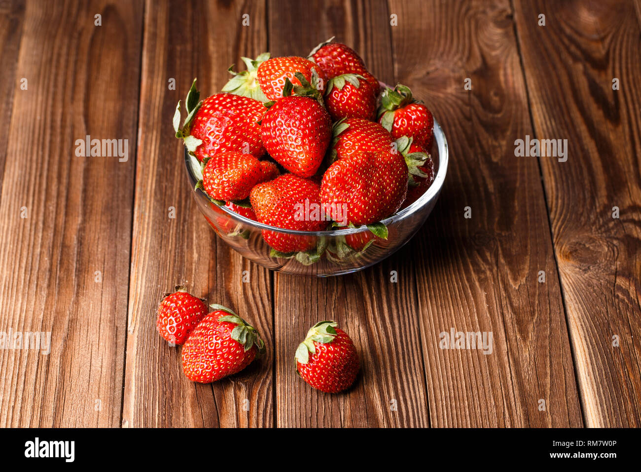 Fresh strawberries on wooden table - Stock Image