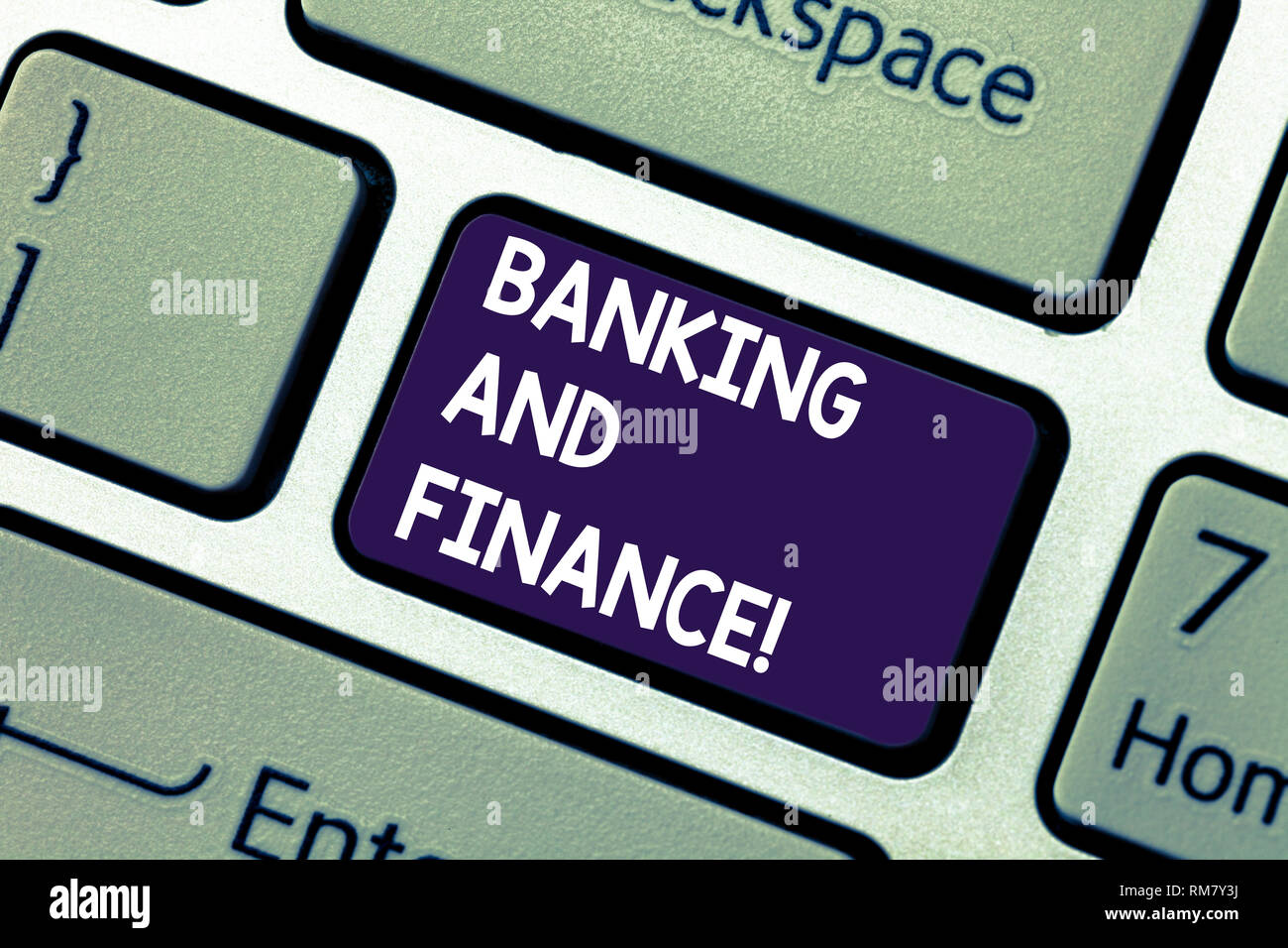 Conceptual hand writing showing Banking And Finance. Business photo showcasing institutions that provide variety of financial services Keyboard key In - Stock Image