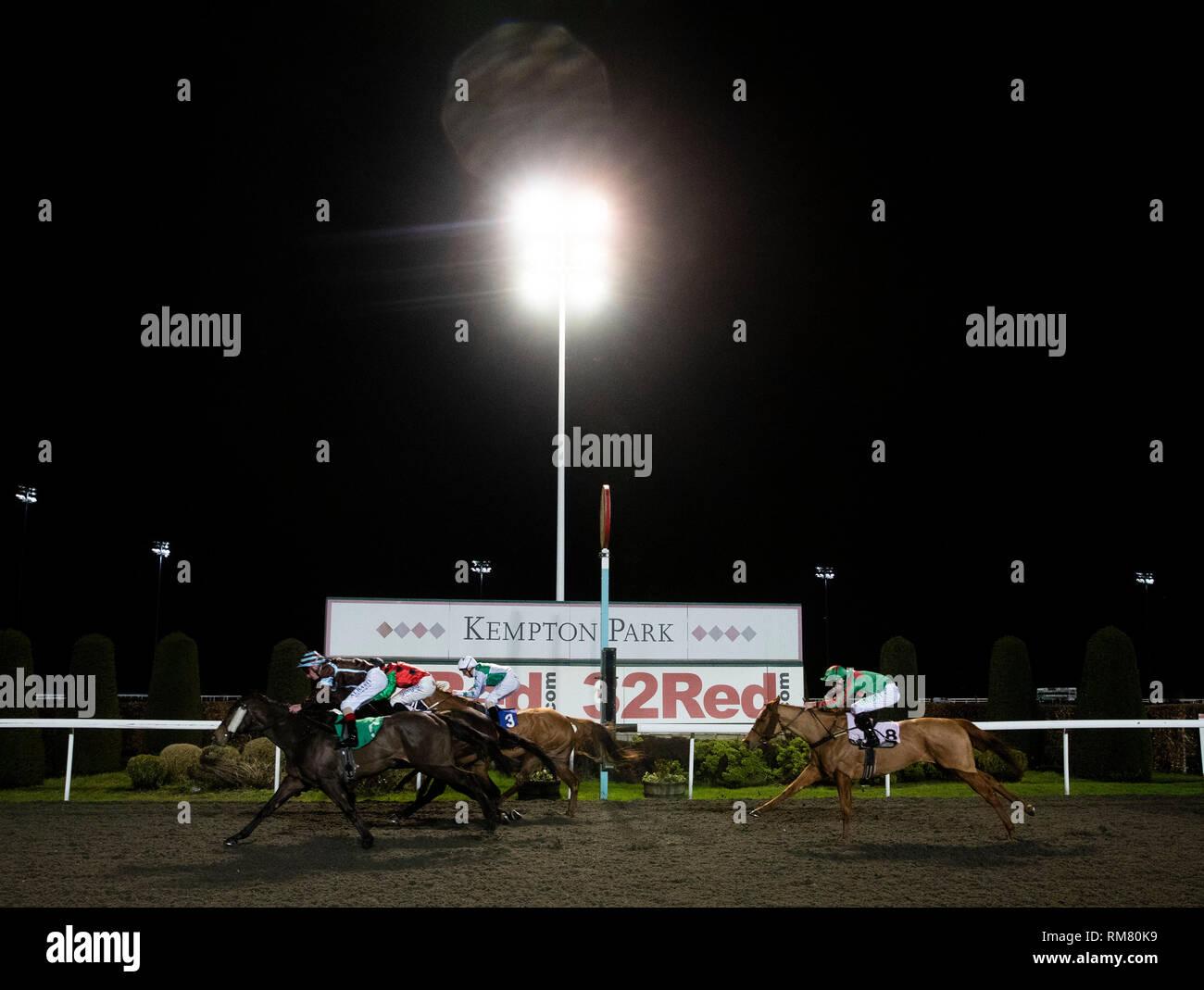 Chica De La Noche (nearside) ridden by Adam Kirby wins the 100% Profit Boost at 32Redsport.com Fillies' handicap stakes at Kempton Park Racecourse, Esher. - Stock Image