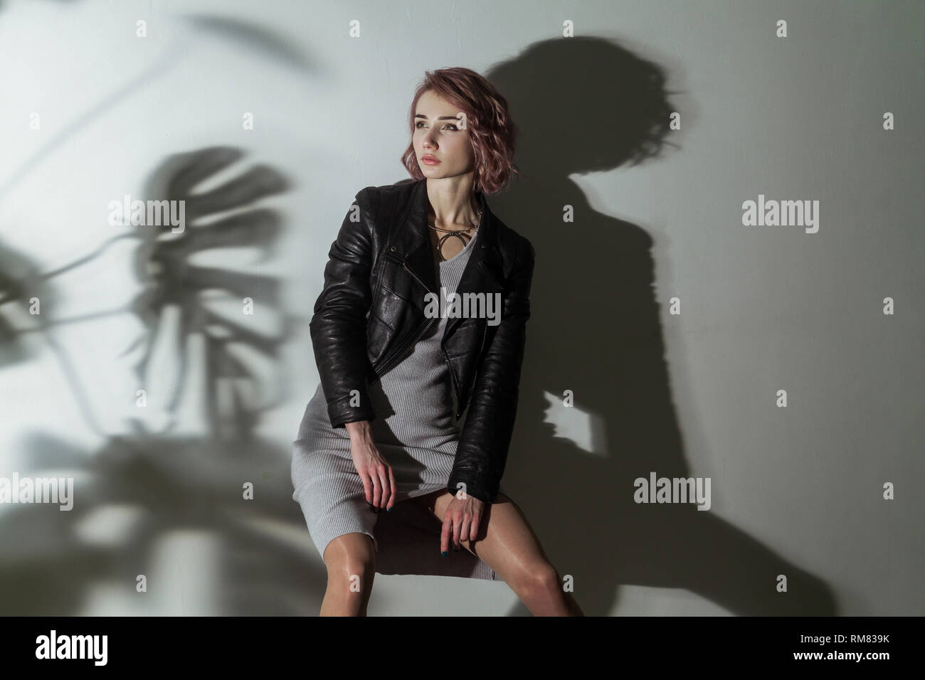 0e4804541d8 beautiful woman with makeup and short pink hair in grey dress and ...