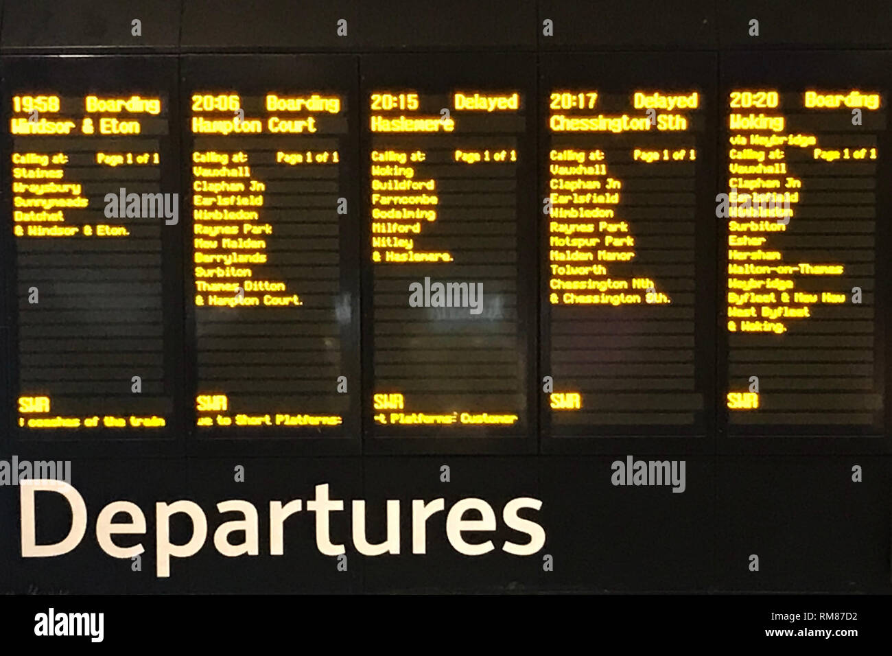 A departure board at Waterloo Station in London, after trains were brought to a standstill during rush hour, resulting in hundreds of commuters being packed into Waterloo Station, following a trespasser getting on to the railway lines. - Stock Image