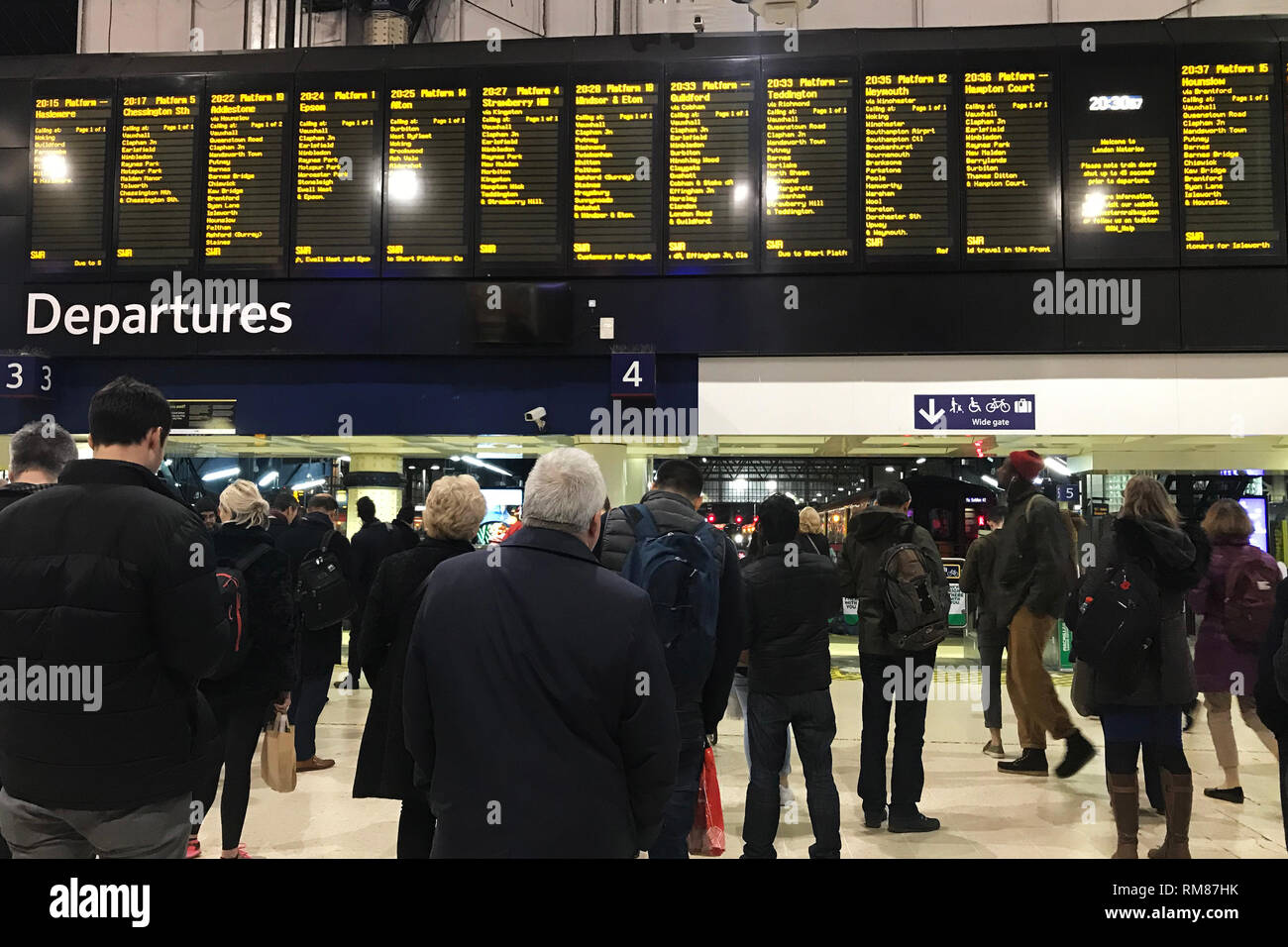People at Waterloo Station in London, after trains were brought to a standstill during rush hour, resulting in hundreds of commuters being packed into Waterloo Station, following a trespasser getting on to the railway lines. - Stock Image