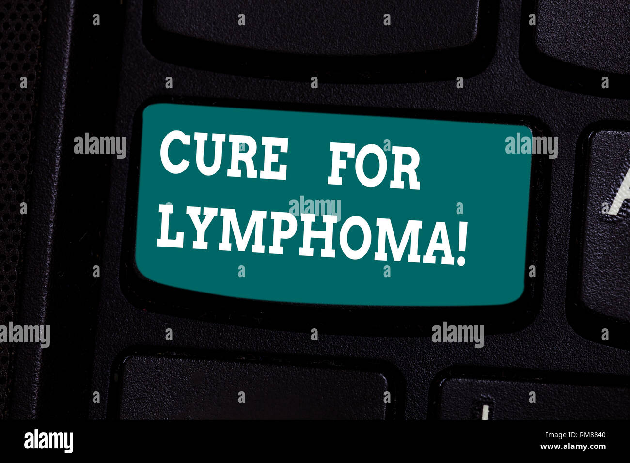 Handwriting text writing Cure For Lymphoma. Concept meaning restore bone marrow by dose chemotherapy radiation therapy Keyboard key Intention to creat - Stock Image