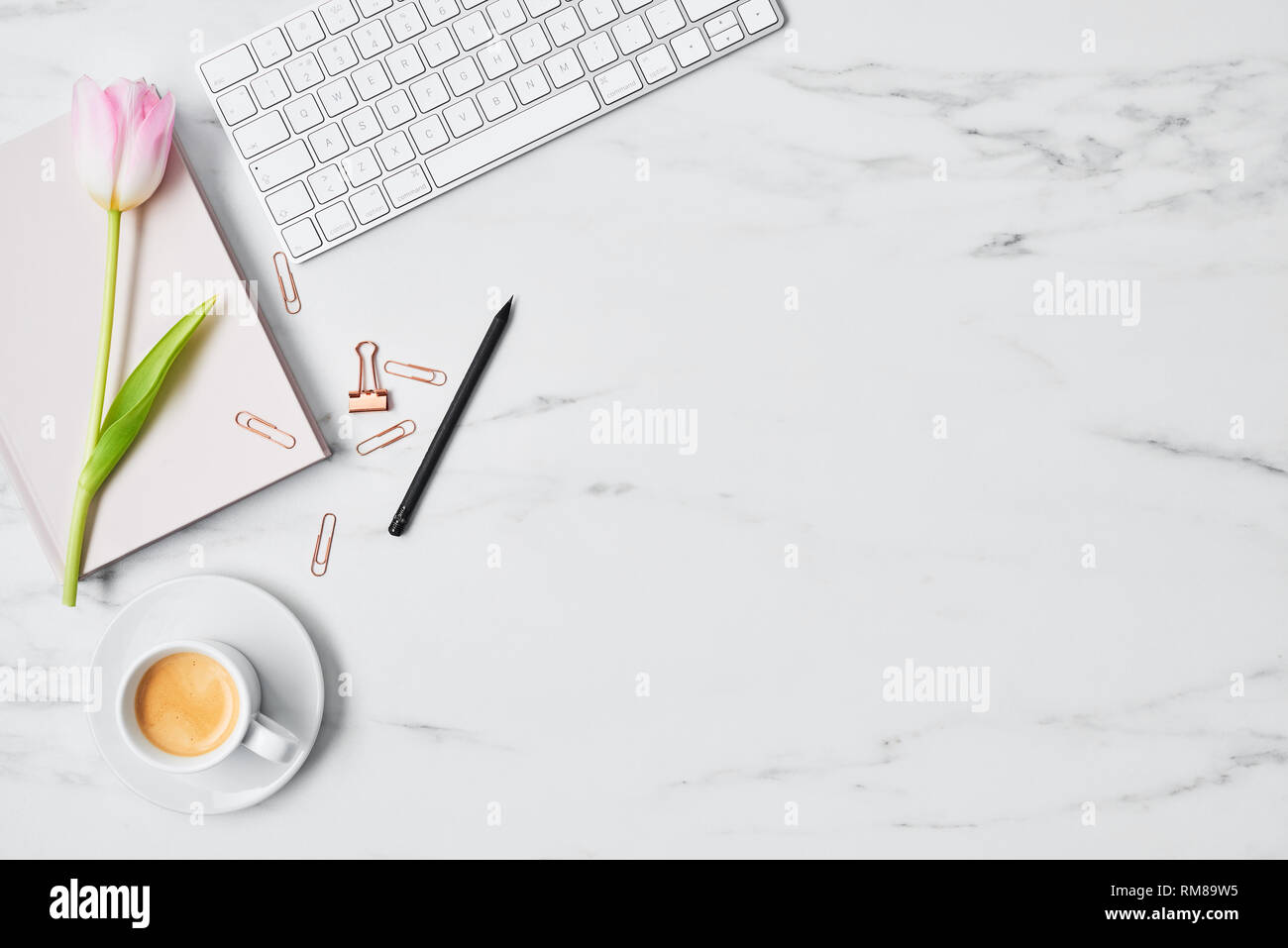 Office Desk With Computer Pink Tulip Coffee Cup And Pink Diary On White Marble Background Flat Lay Copy Space For Text Top View Stock Photo Alamy