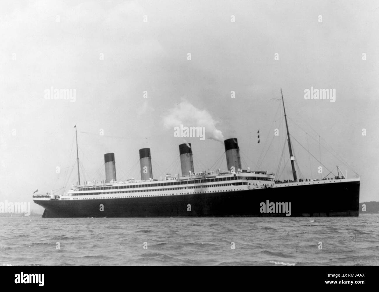 maiden voyage of the RMS olympic passenger ship, sister ship to the Titanic in 1911 showing the smaller number of lifeboats than she would carry after the titanic disaster - Stock Image
