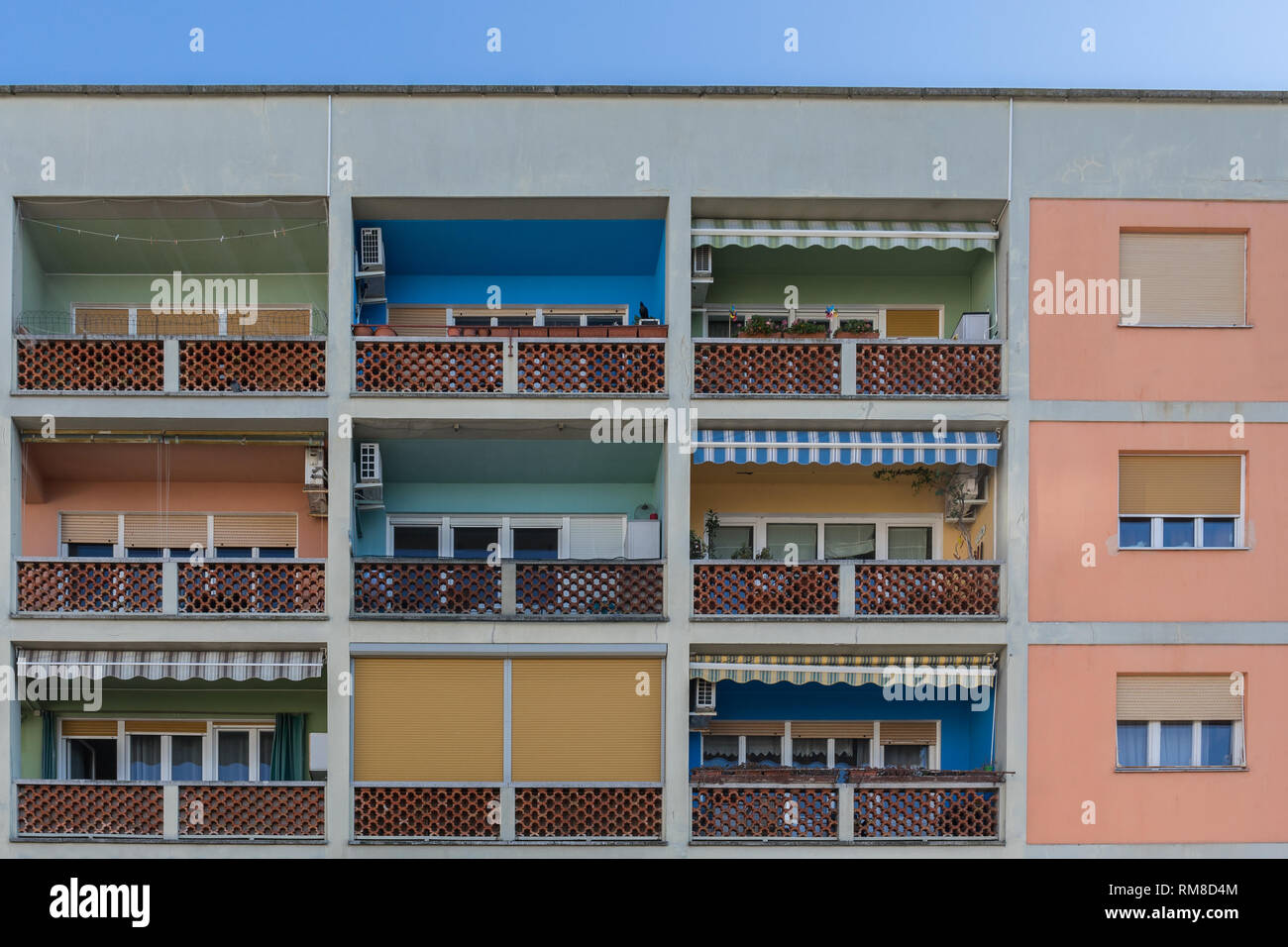 Multistorey apartments building with colorful balconies - Koper, Slovenia - Stock Image